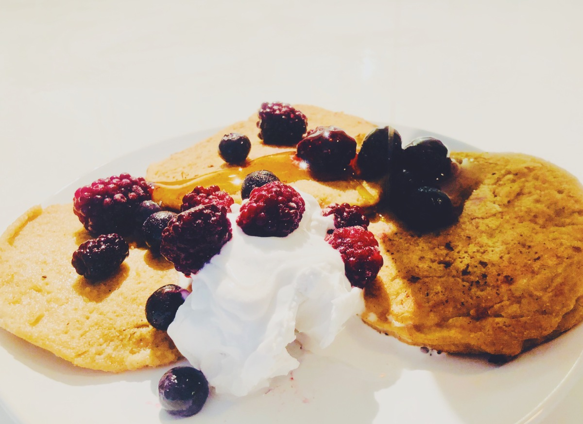 Oat Flour Pancakes with Coconut Milk Whipped Cream and Berries